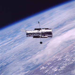 HST in orbit over Earth