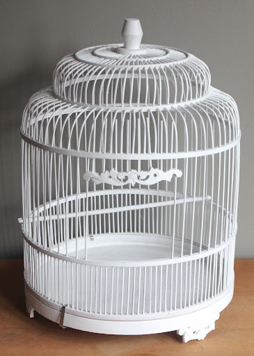 White birdcage available for rent from www.momentarilyyours.com, $5.00.