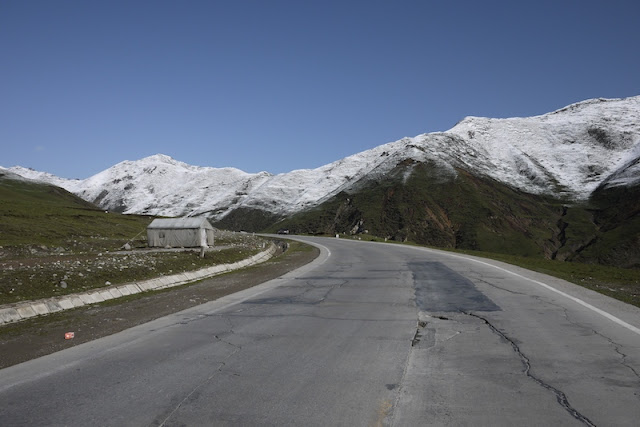 road scene with snow covered mountains in Qinghai, China