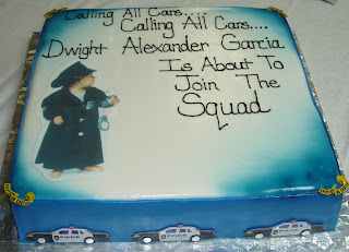 Custom designed white and blue fondant baby shower cake with Police officer and squad cars
