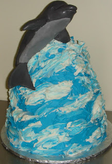 3D molding chocolate dophin on a custom butter cream wave birthday cake