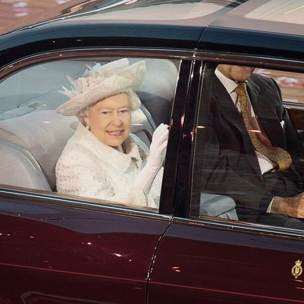Queen Elizabeth waves from her vehicle as she arrives at the Commonwealth Games opening ceremony at Celtic Park in Glasgow, Scotland on Wednesday, July 23, 2014.