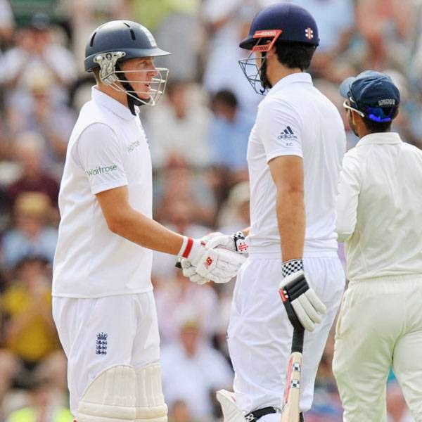 England's Gary Ballance (L) shakes hands with Alastair Cook after reaching 50 runs on the first day of the third cricket Test match between England and India at The Ageas Bowl cricket ground in Hampshire on July 27, 2014.