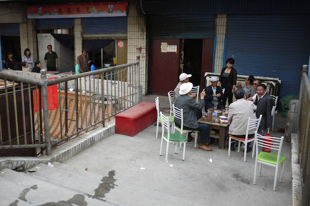 men drinking tea outside in Xining, Qinghai, China