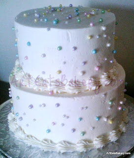 Two tier butter cream anniversary cake with pastel sugar pearls