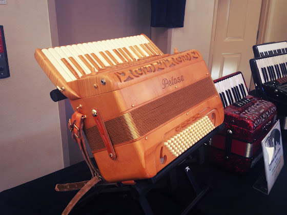 A beautiful wood grain Petosa accordion.