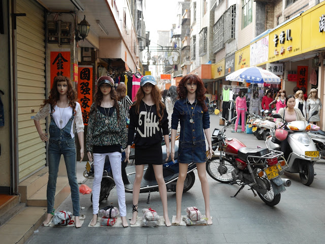 mannequins next to a motorbike in Yangjiang, China
