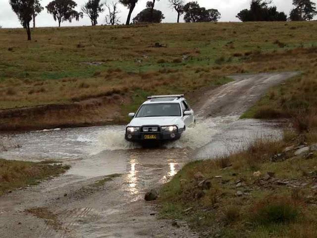 Subaru crossing a shallow causeway