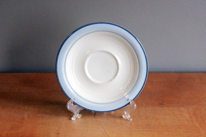 Blue stoneware saucers available for rent from www.momentarilyyours.com, $0.50 each.
