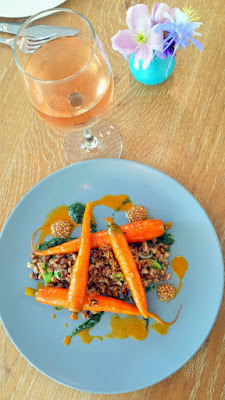 Glyph Café & Art Space Whole Vegetable Special of Carrots with Heirloom Carrots in a carrot emulsion, carrot top pesto, salted green garlic and toasted farro