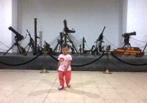 Kiara in front of  Indonesian Army's artillery those days