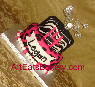 Two tier pink animal print birthday cake with crystal topper