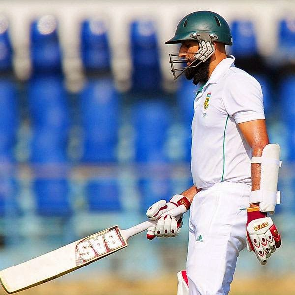 South Africa cricket captain Hashim Amla walks back to the pavilion after his dismissal during the first day of the opening Test match between Sri Lanka and South Africa at the Galle International Cricket Stadium in Galle on July 16, 2014.