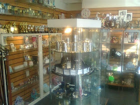 glass cabinet spotlit display of modern items at Locks & Leather shop