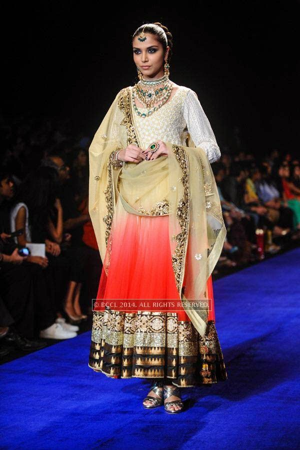A model walks the ramp for Golecha Jewels on Day 3 of India International Jewellery Week (IIJW), 2014, held at Grand Hyatt, in Mumbai.