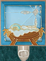 manger nativity stained glass in blue