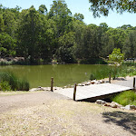 Timber bridge by large pond in Richley Reserve (401575)