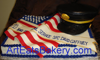 Millitary retirement custom cake with the American Flag and 3D hat