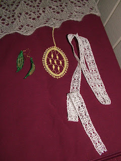 Margaret's bobbin lace earrings, ornament, and the edging she was working on in March