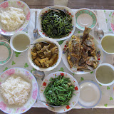Lunch at a demonstration farm in Mwabi district, outside of the city