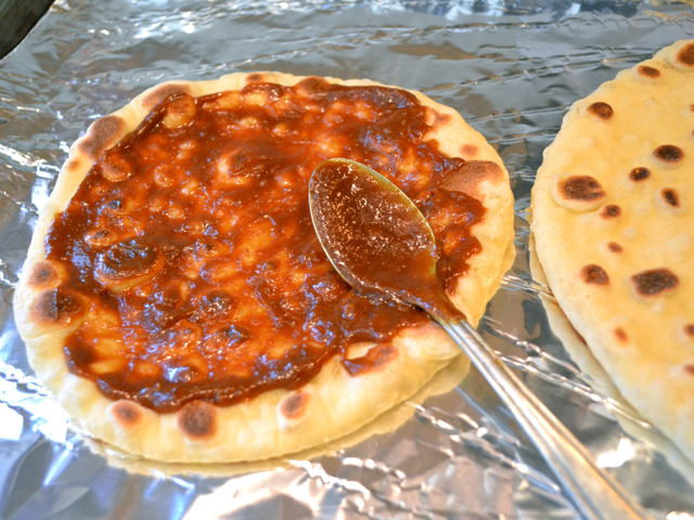 naan topped with pizza sauce