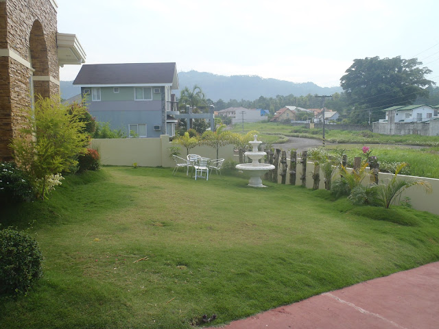Dipolog house and lost for sale front garden
