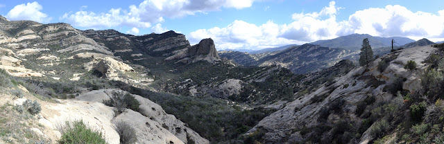 panorama of the canyon striped in green and white