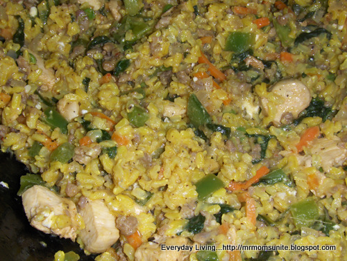 photo of chicken with sausage,brown rice, vegetables, and spinach
