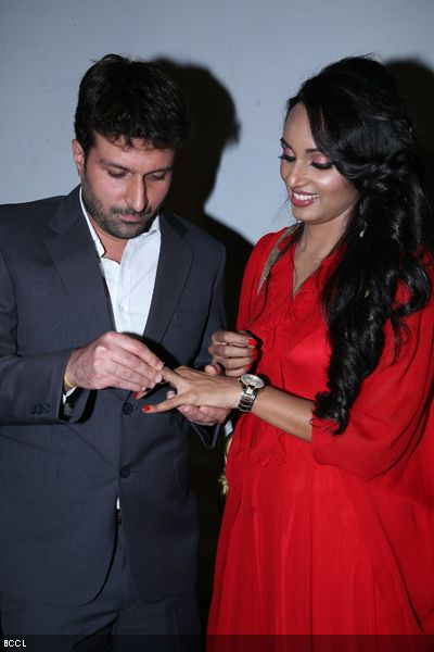 Siddharth Vasudev slips engagement ring in the hands Resshmi Ghosh.