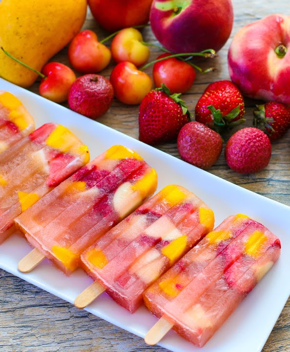 overhead photo of four Iced Tea Sangria Ice Pops surrounded by fresh fruit