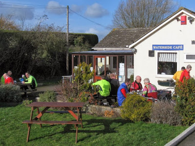Cyclists outside cafe in sunshine