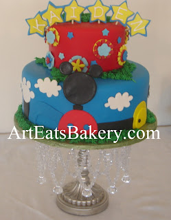 Creative two tier Mickey mouse Clubhouse Boy's blue, red and yellow fondant birthday cake design idea with gears and stars
