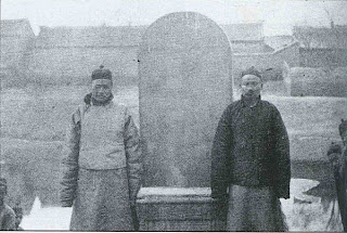 Two Chinese Jews in front of the stone commemorating the building of the synague