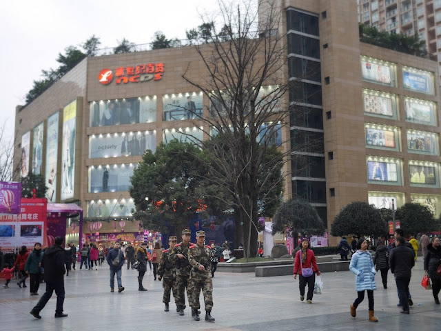 Three male People's Armed Police at a shopping street in Dadukou, Chongqing