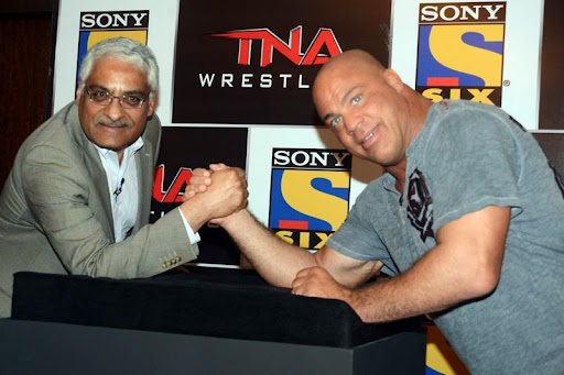 Mr. Man Jit Singh, CEO, MSM India with Kurt Angle.JPG