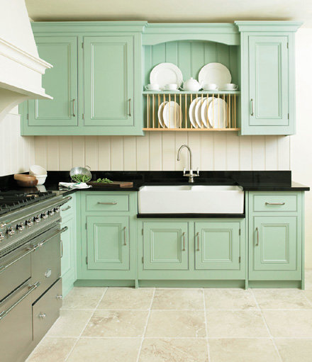 This casual colorful kitchen is exceptional. The cabinets are the perfect shade of turquoise and the black counter tops sing against them! & the pretty things: Dreaming of Kitchens... azcodes.com