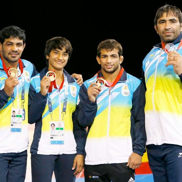 Indian teenager Vinesh Phogat then made it a double delight as she registered a thrilling 11-8 win over England's Yana Rattigan to clinch the gold medal in the women's freestyle 48kg wrestling competition. It was the second gold medal for India from wrestling after Amit Kumar's triumph in the 57kg category.