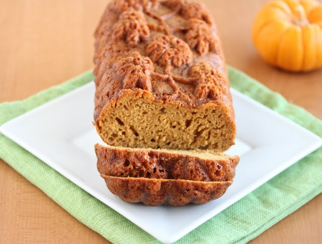 photo of a pumpkin loaf with two slices