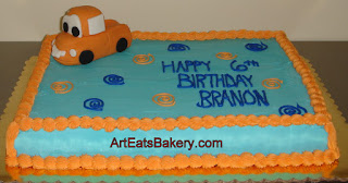 Blue butter cream kid's birthday cake with little fondant truck