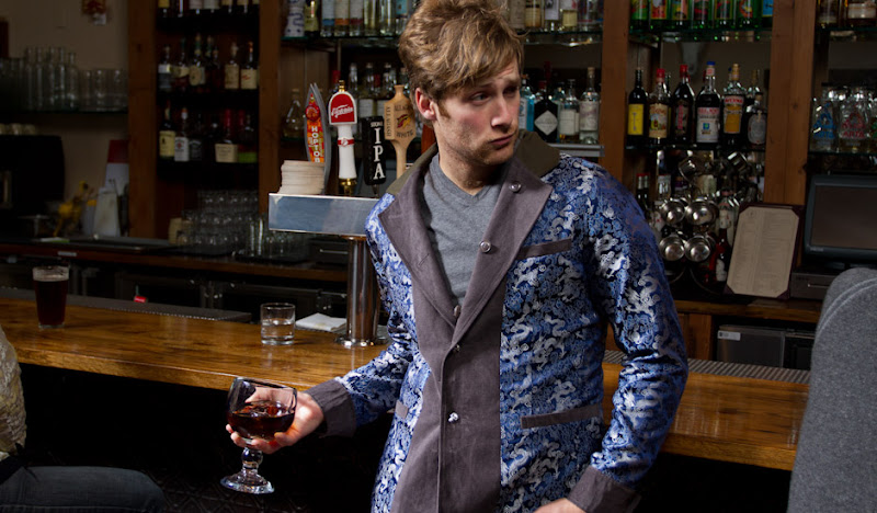 Dylan looks smug at West of Pecos in Gray Reversible Drinking Jacket
