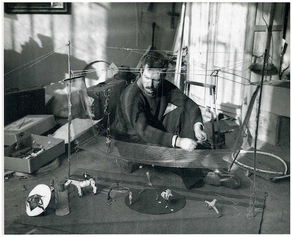 Alexander Calder with his circus. Paris, 1929. Andre Kertesz.