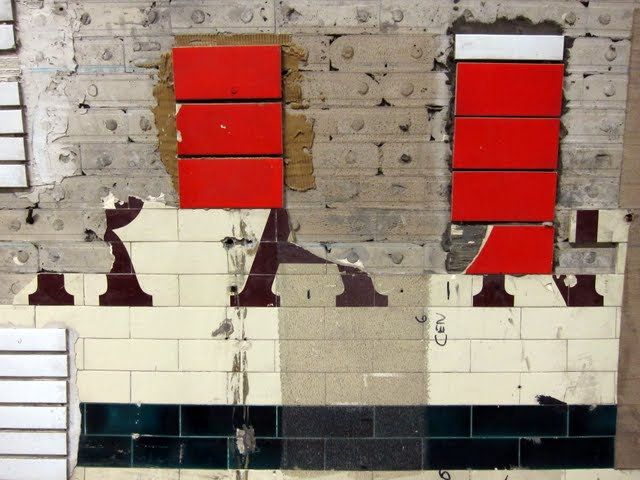 Testing tiles in the disused Aldwych tube station in London
