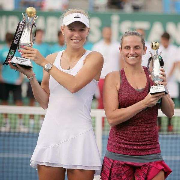 Caroline Wozniacki of Denmark, left, and Roberta Vinci of Italy hold their trophies after their tennis final match at the Istanbul Cup in Istanbul, Turkey, Sunday, July 20, 2014