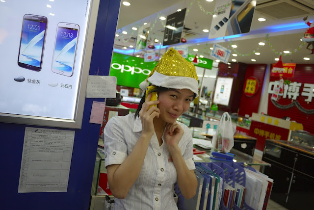 young woman wearing a sparkly yellow Santa hat in Putian, China