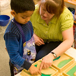This preschool boy at the Irvine Montessori school near Woodbridge is receiving a geography lesson in land and water forms. He's learning that a strait is a narrow band of water between two bodies of land, and an isthmus is a narrow band of land between water. (Did you remember the meaning of those terms?)