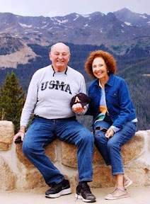 Diane and Joe, shortly after their 49th Wedding Anniversary, sitting on a wall at the Continental Divide in Rocky Mountain National Park