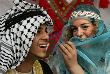 Palestinian students wear traditional clothing during a cultural event at the Bethlehem University, in the West Bank town of Bethlehem, Thursday, March 22, 2007. (AP Photo/Kevin Frayer)