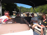 the resort manager takes us out for a boat ride