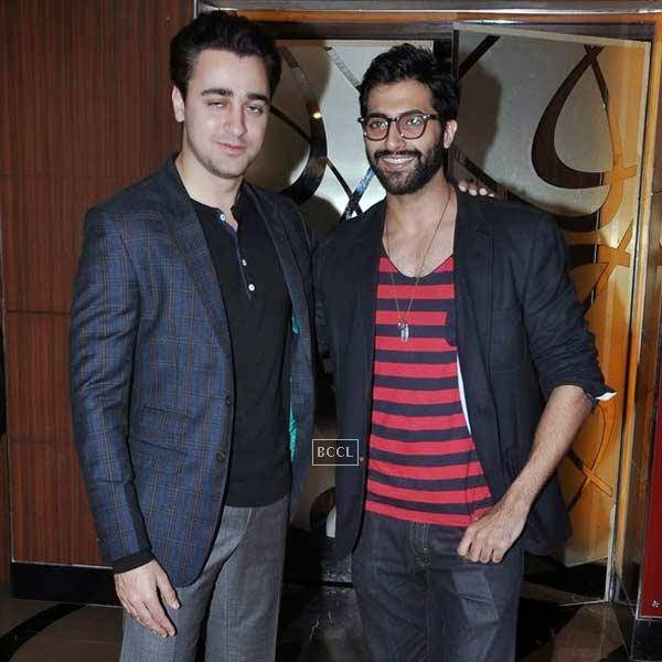 Imran Khan and Akshay Oberoi pose together during the premiere of Bollywood movie Pizza, held at PVR in Mumbai, on July 17, 2014.(Pic: Viral Bhayani)