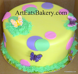 Yellow, pink, green and purple polka dot fondant unique girls birthday cake with edible sugar butterflies